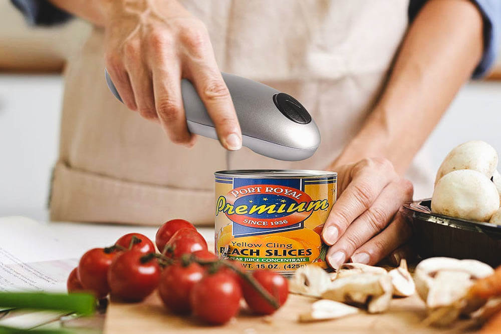 opening food can with a hand-held can opener