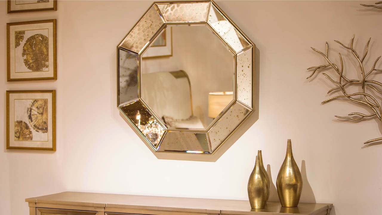 mirror hanging on plaster wall